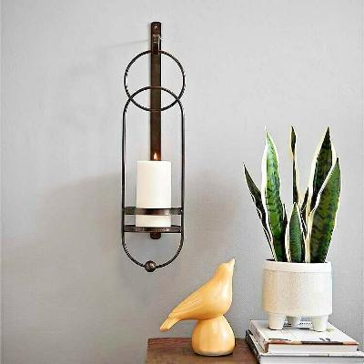 Bronze Oval Geometric Metal Sconce. Brings a refined elegance to any wall.