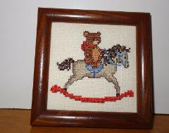 Finished Cross Stitch picture of Teddy Bear riding a Rocking H...