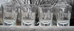 Set of 4 Three Olives Vodka shot glasses 1 oz white logo